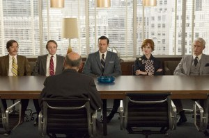 Kevin Rahm as Ted Chaough, Vincent Kartheiser as Pete Campbell, Jon Hamm as Don Draper, Christina Hendricks as Joan Harris and Jon Hamm as Don Draper - Mad Men _ Season 7B, Episode 11 - Photo Credit: MIchael Yarish/AMC