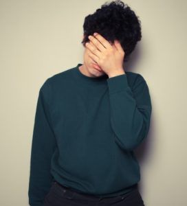 Stock Photo Man Covering Face Cropped